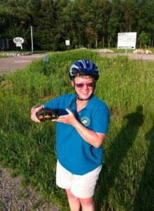 Tracey Koenig,Wild Ones Fox Valley Area Chapter board member and Executive Director of Heckrodt Wetland Reserve, with a Blanding's Turtle she spotted while riding her bicycle near the WILD Center.
