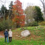 Hikers passing some of the many rocks and boulders throughout the Arboretum.