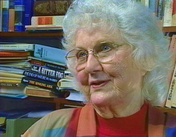 Lorrie Otto in her library.